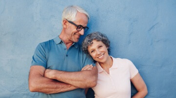 Ardmore All-On-4 Dentures smiling man linking arms with woman