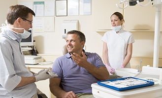 Man talking to dentist about insurance