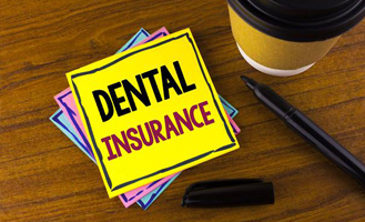 Dental Insurance written on yellow note pad
