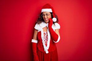 woman in Santa hat with toothache