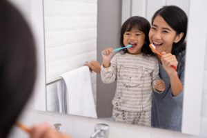 parent brushing teeth with child in ardmore
