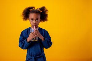 Child drinking juice that causes children's cavities