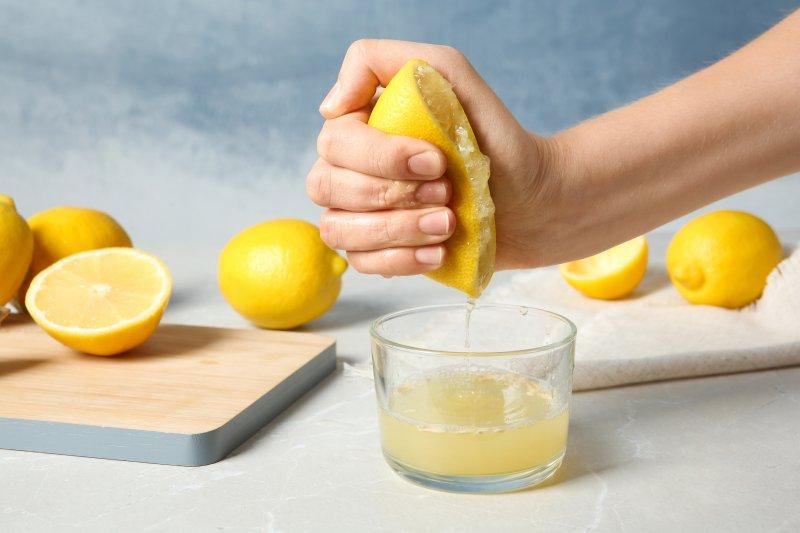Person juicing lemons